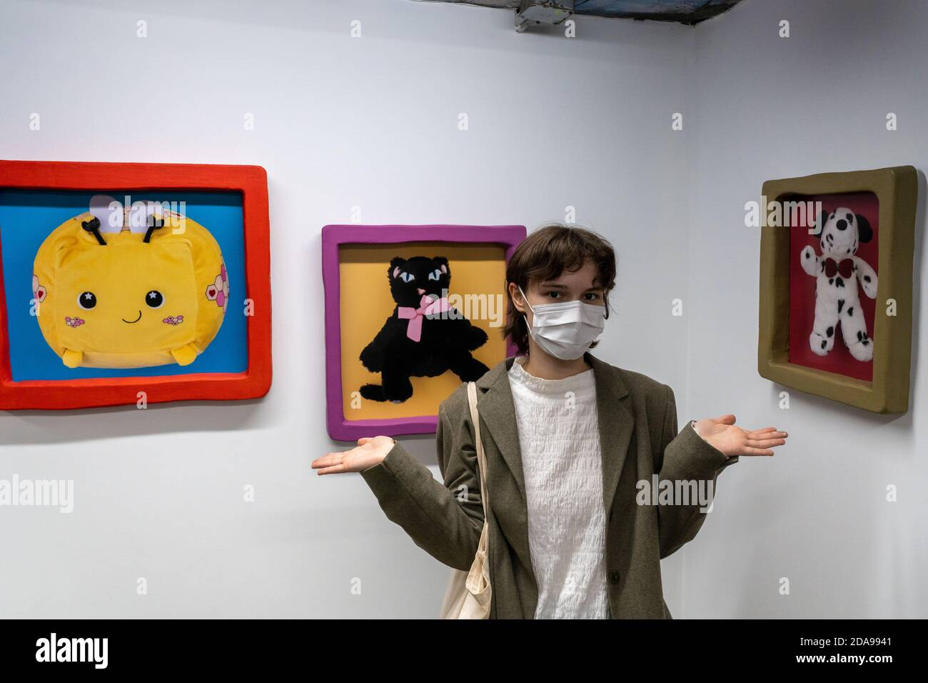 """NEW YORK, NY - NOVEMBER 11, 2020: Artist Stefany Lazar attends her show """"Stuffed Animals and Princess Peach"""" at Love gallery in New York City. Stock Photo"""