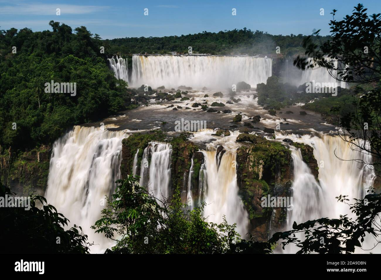"Foz do Iguaçu, Brazil. 16th February, 2017. View of ""Salto Rivadavia"" (top), ""Salto Tres Mosqueteros"" (bottom) and ""Salto Dos Mosqueteros"" waterfalls at Iguazu National Park in Argentina, viewed from the Brazilian side, Iguaçu National Park, Parana State, Brazil. Stock Photo"