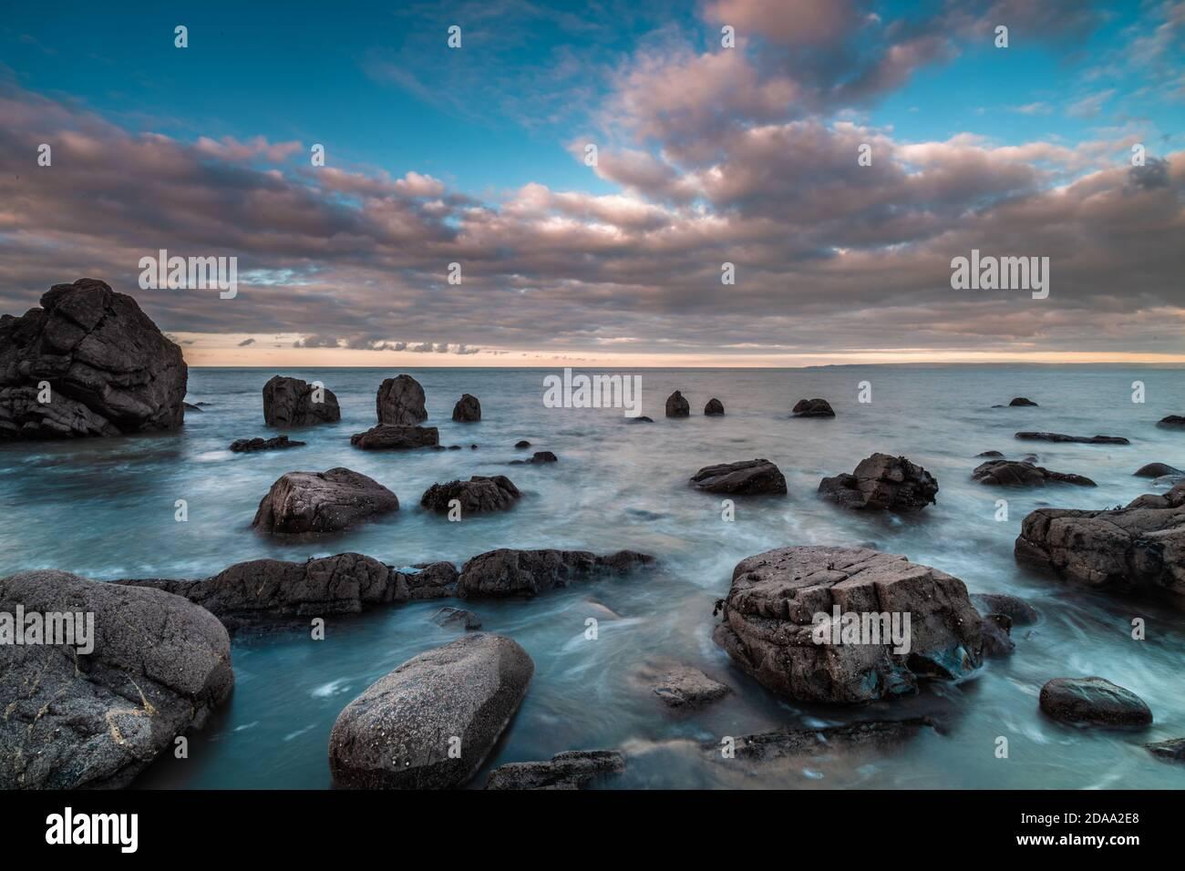 long Exposure of the sea and rocks rocks at black church rock Devon Stock Photo