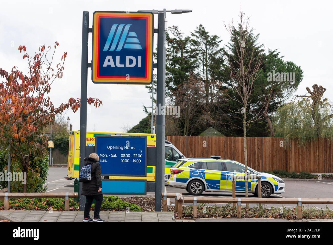 Police and ambulances have attended an Aldi store in Westcliff on Sea, Essex, UK, due to a fatality. Person looking at opening hours Stock Photo