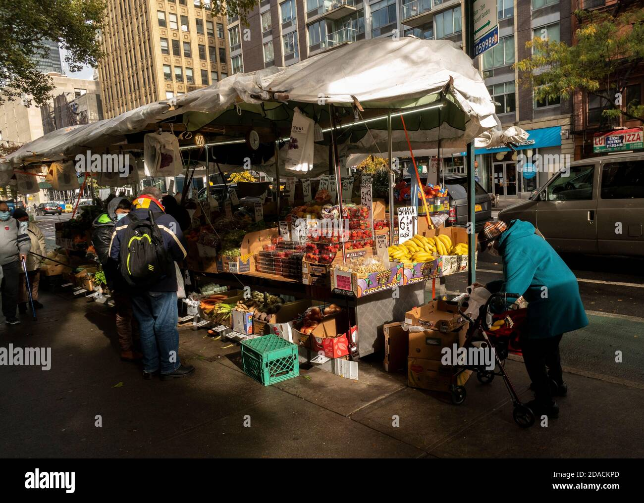 Customers at a fruit stand in Chelsea in New York on Saturday, October 31, 2020.  (© Richard B. Levine) Stock Photo