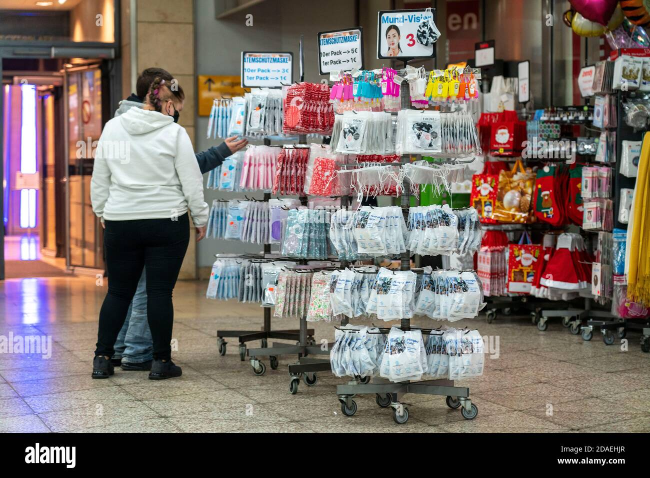 Sales stand with masks, mouth-and-nose protection, disposable masks, fabric masks, in the underground station in Essen, NRW, Germany Stock Photo
