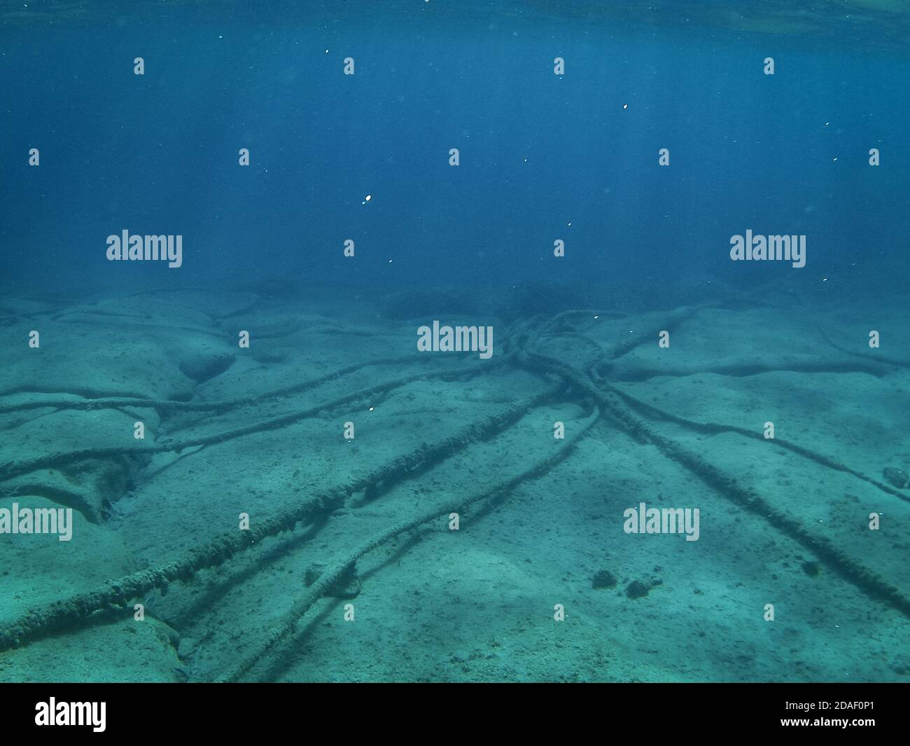 Underwater cables on the ocean floor in the Mediterranean Sea. Stock Photo