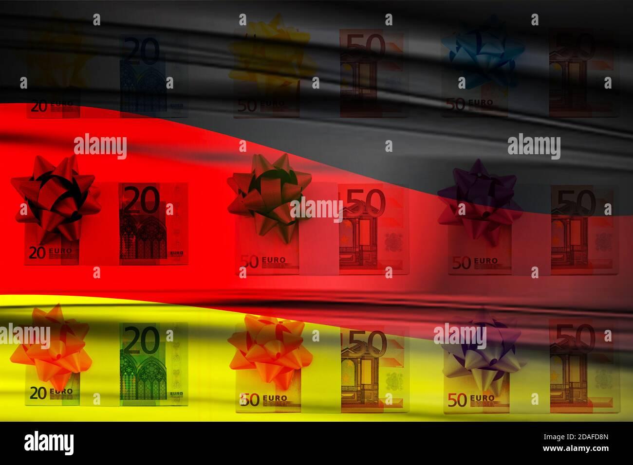 Euro Bargeld mit Geschenkschleife und Flagge Deutschland Stock Photo