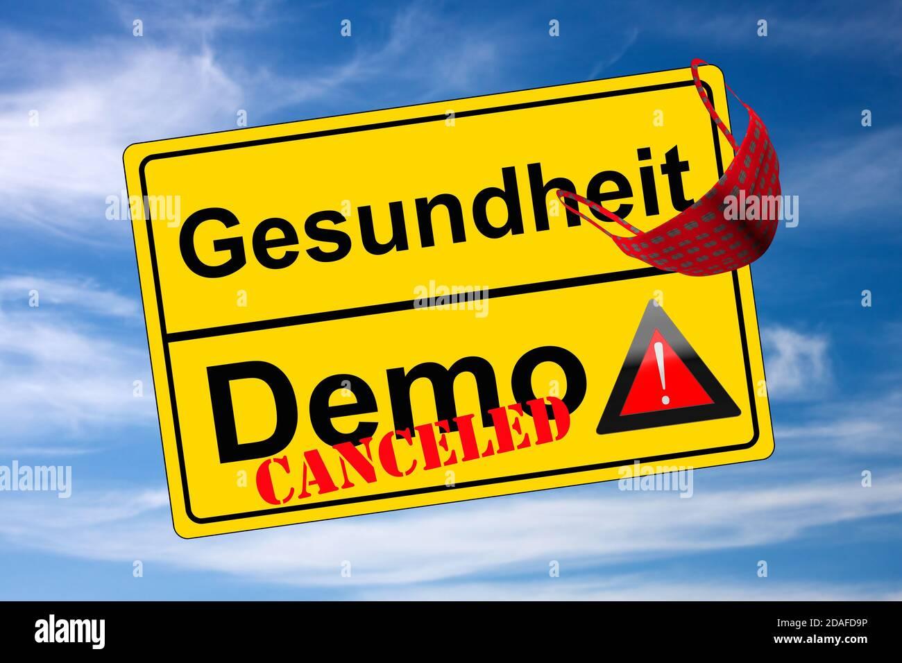 Ortschild auf Himmel Demo canceled kontra Gesundheit Stock Photo