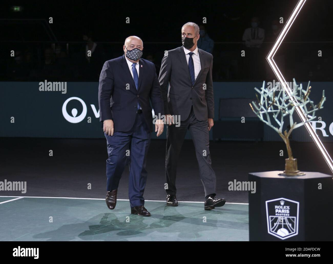 President of French Tennis Federation FFT Bernard Giudicelli and Director of the Rolex Paris Masters Guy Forget during the trophy ceremony of the me P Stock Photo