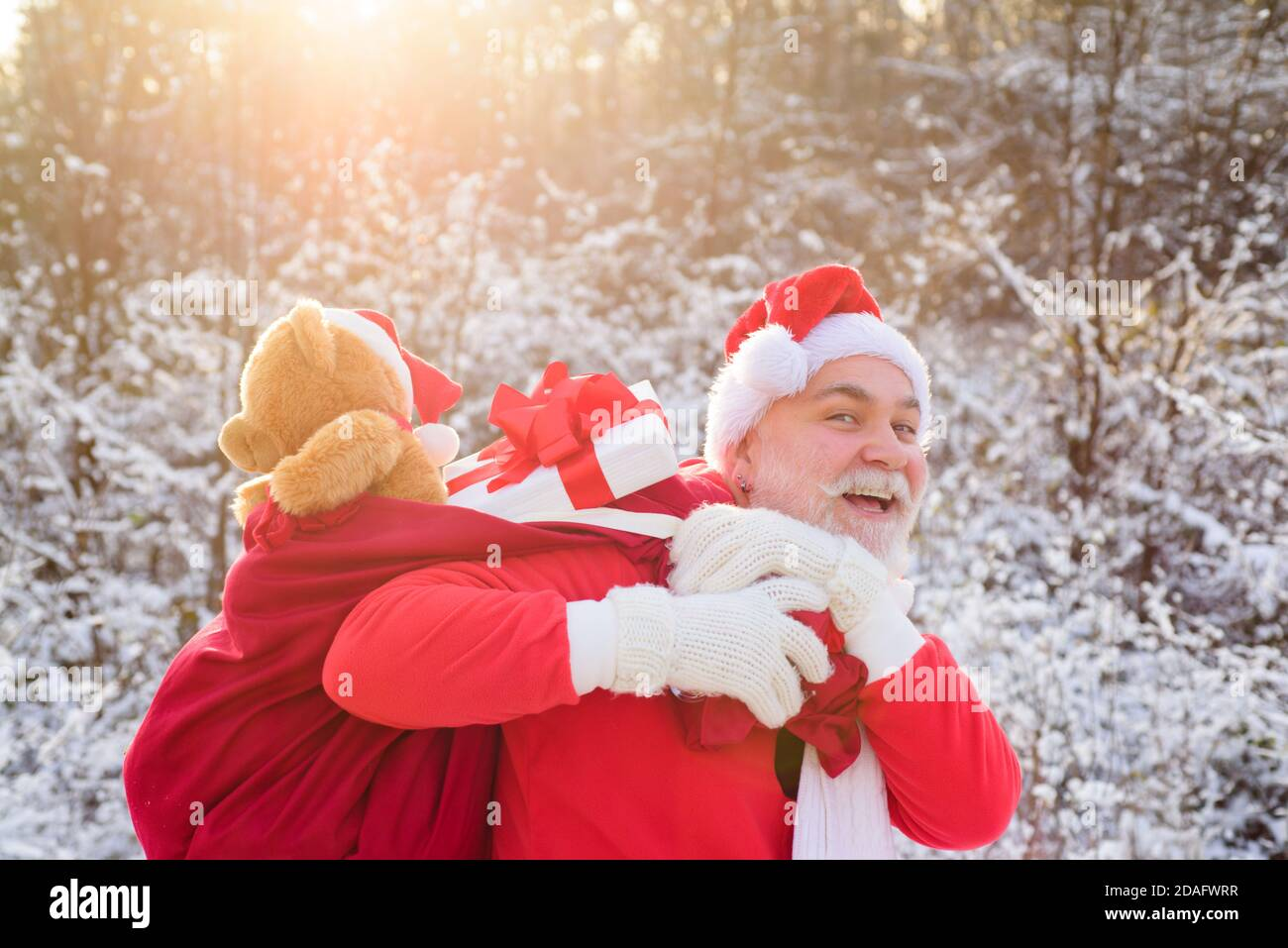 Santa Grandfather Deliver Gifts Santa Claus In Christmas Suits In Snowy Winter Mountain New Year And Xmas Is Coming Stock Photo Alamy