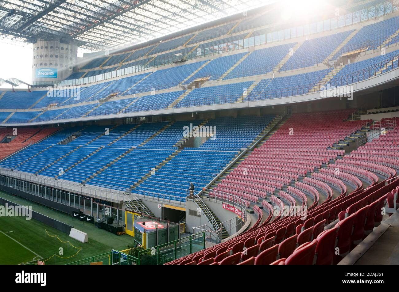 Empty stands of blue and red in the stadium Giuseppe Meazza or San Siro, built in 1925. Milan. Italy. Stock Photo