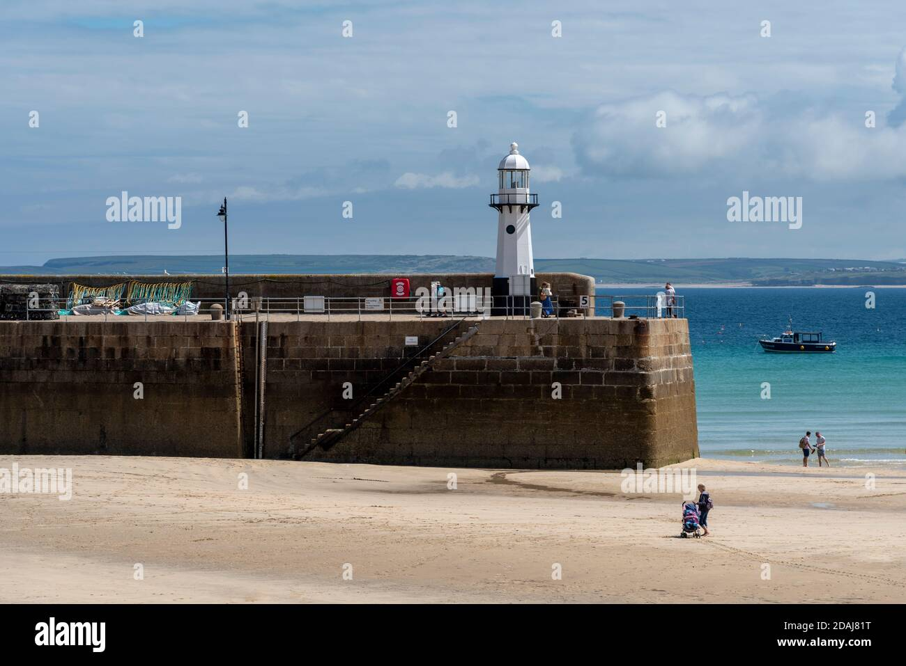 Smeatons Pier Lighthouse, St Ives harbour at low tide, Cornwall, UK Stock Photo