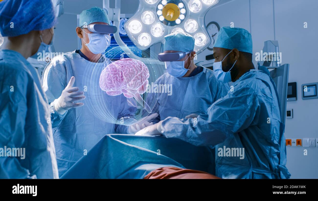 Surgeons Wearing Augmented Reality Glasses Perform Brain Surgery with Help of Animated 3D Brain Model, Using Gestures. High Tech Technologically Stock Photo