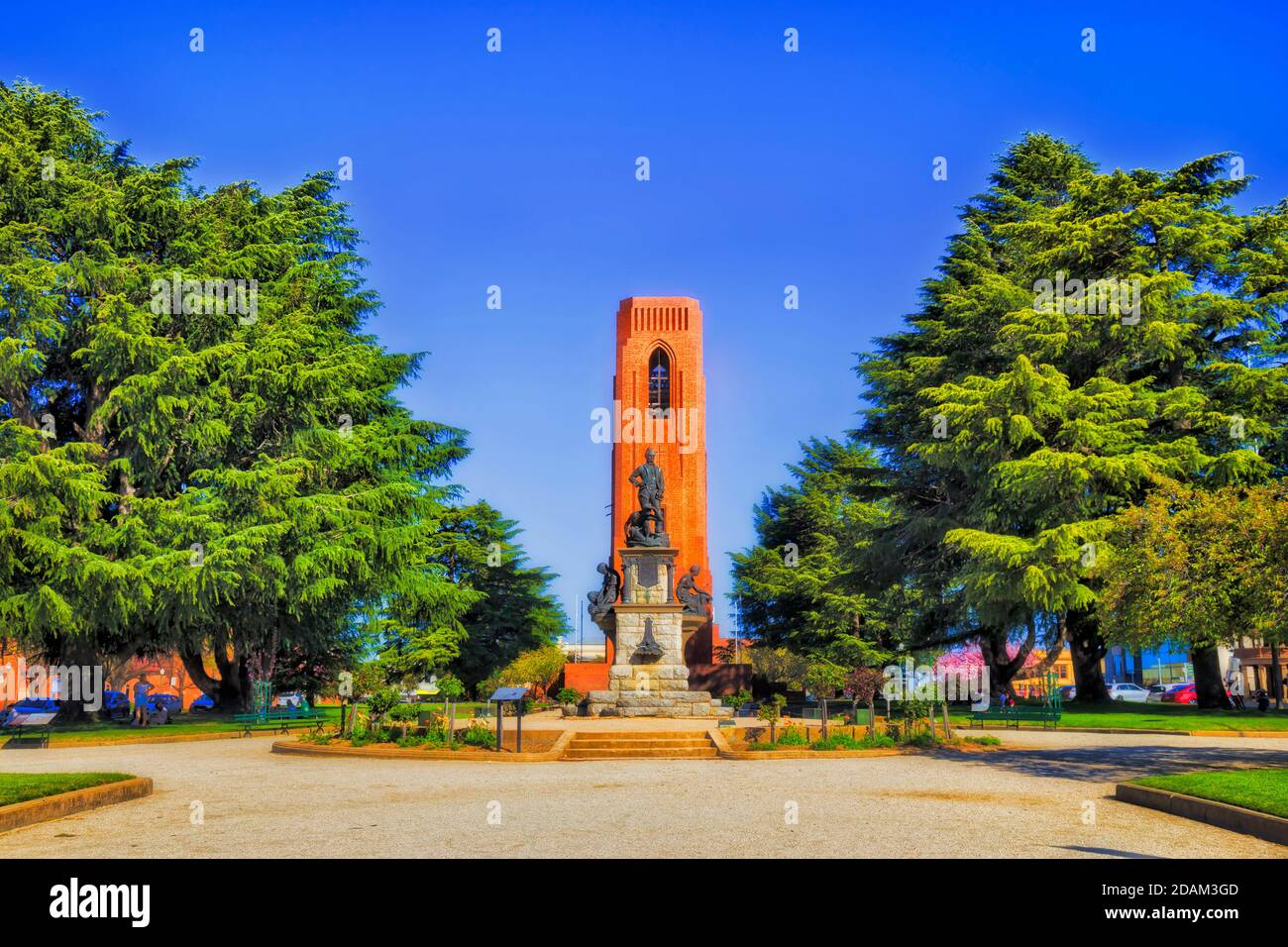 Public park in Bathurst city of regional Australia on a sunny day with statue and war memorial around bell tower - kings parade and George street. Stock Photo