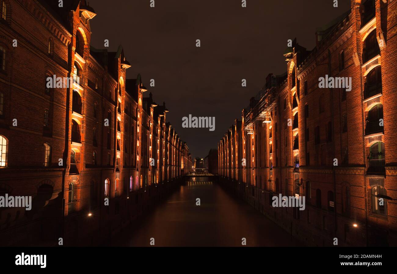 Speicherstadt perspective at night, warehouse district in Hamburg, Germany, the largest warehouse district in the world where the buildings stand on t Stock Photo