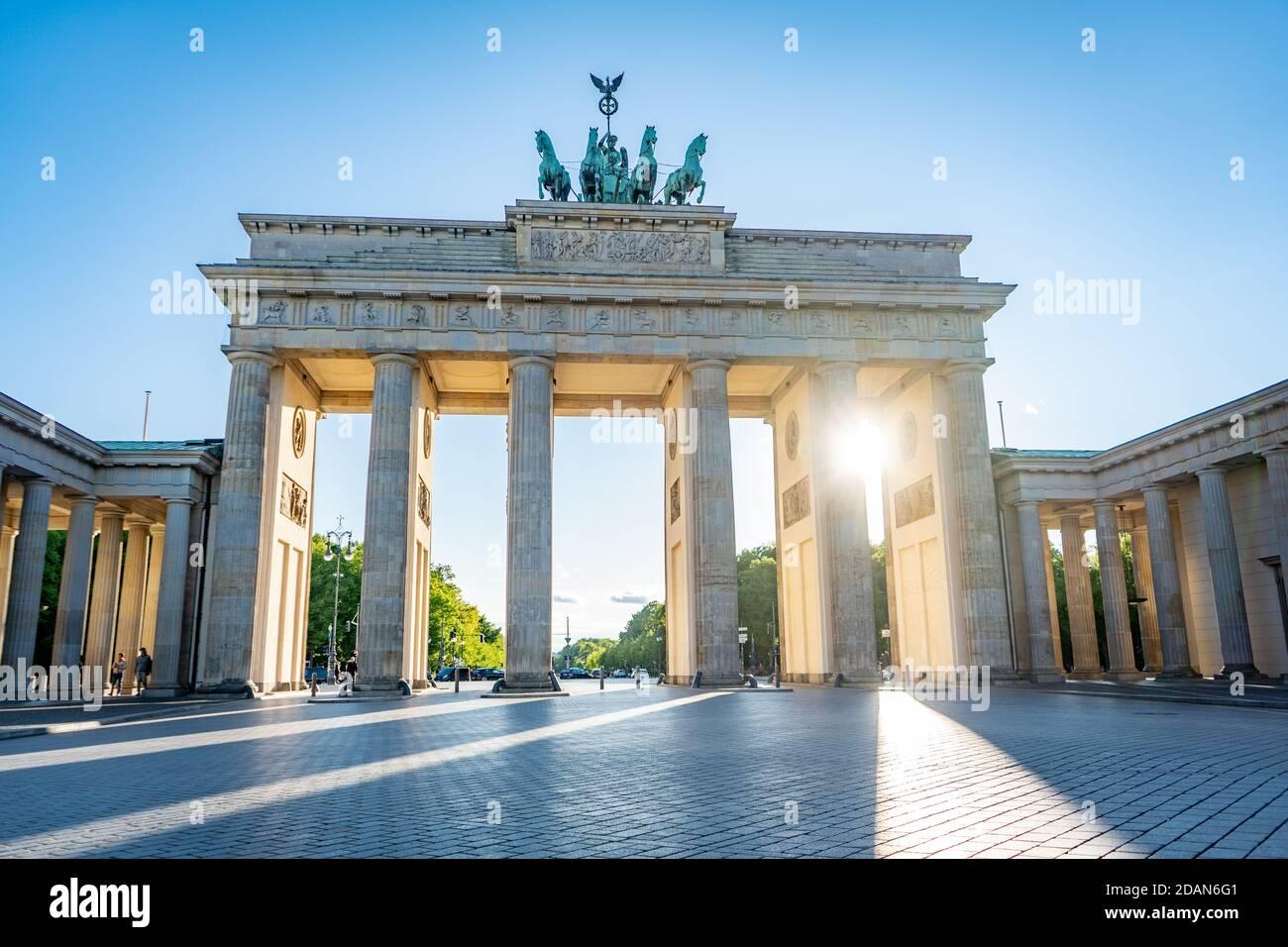 sun shining through brandenburg gate berlin germany Stock Photo