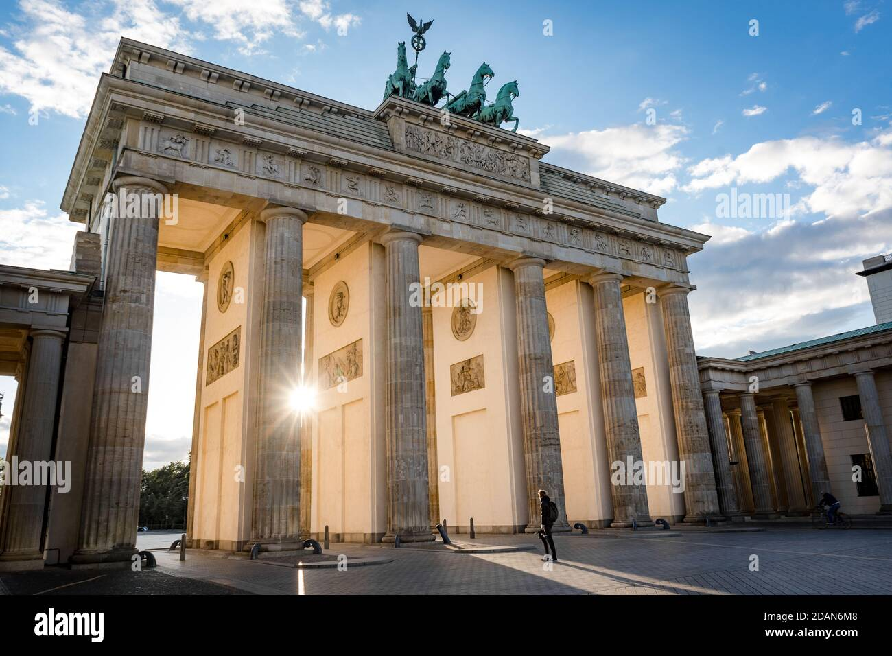 man standing in front of brandburg gate berlin germany during sunset Stock Photo