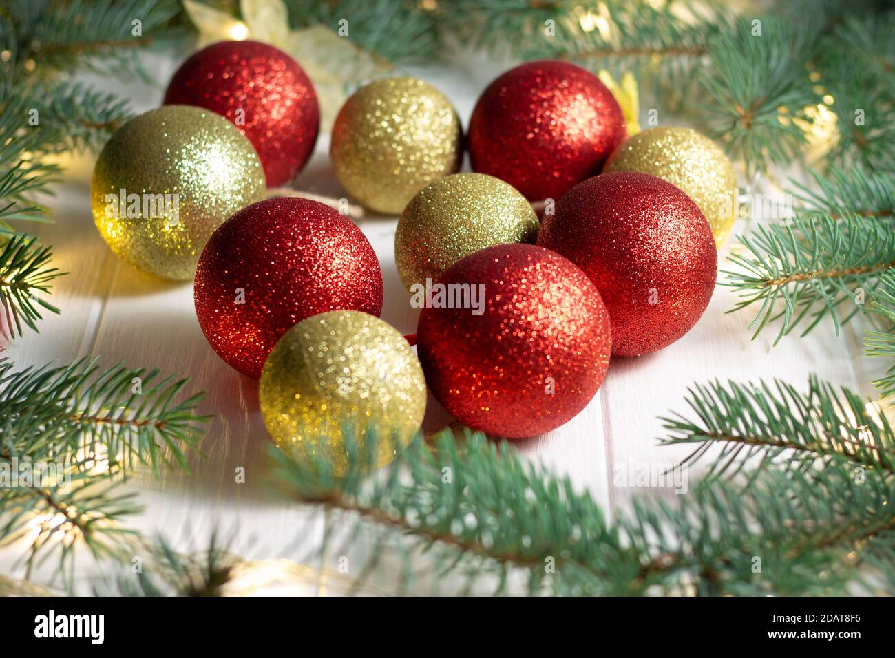 Green Branches Of A Christmas Tree With Led Light Bulbs Garland And Shiny Balls On A White Wooden Background Merry Christmas And Happy New Year Conc Stock Photo Alamy