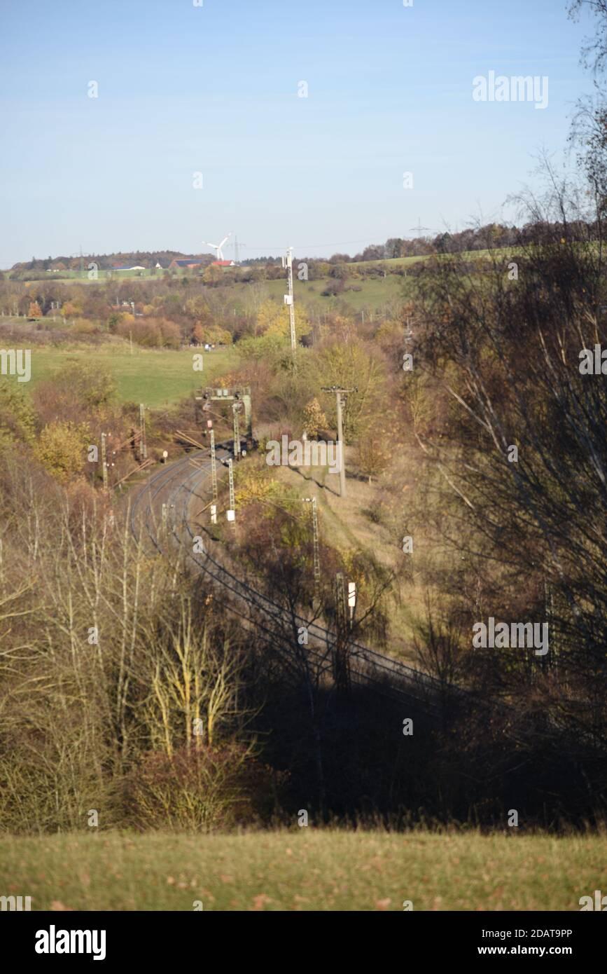 Rails leading towards autumn Stock Photo
