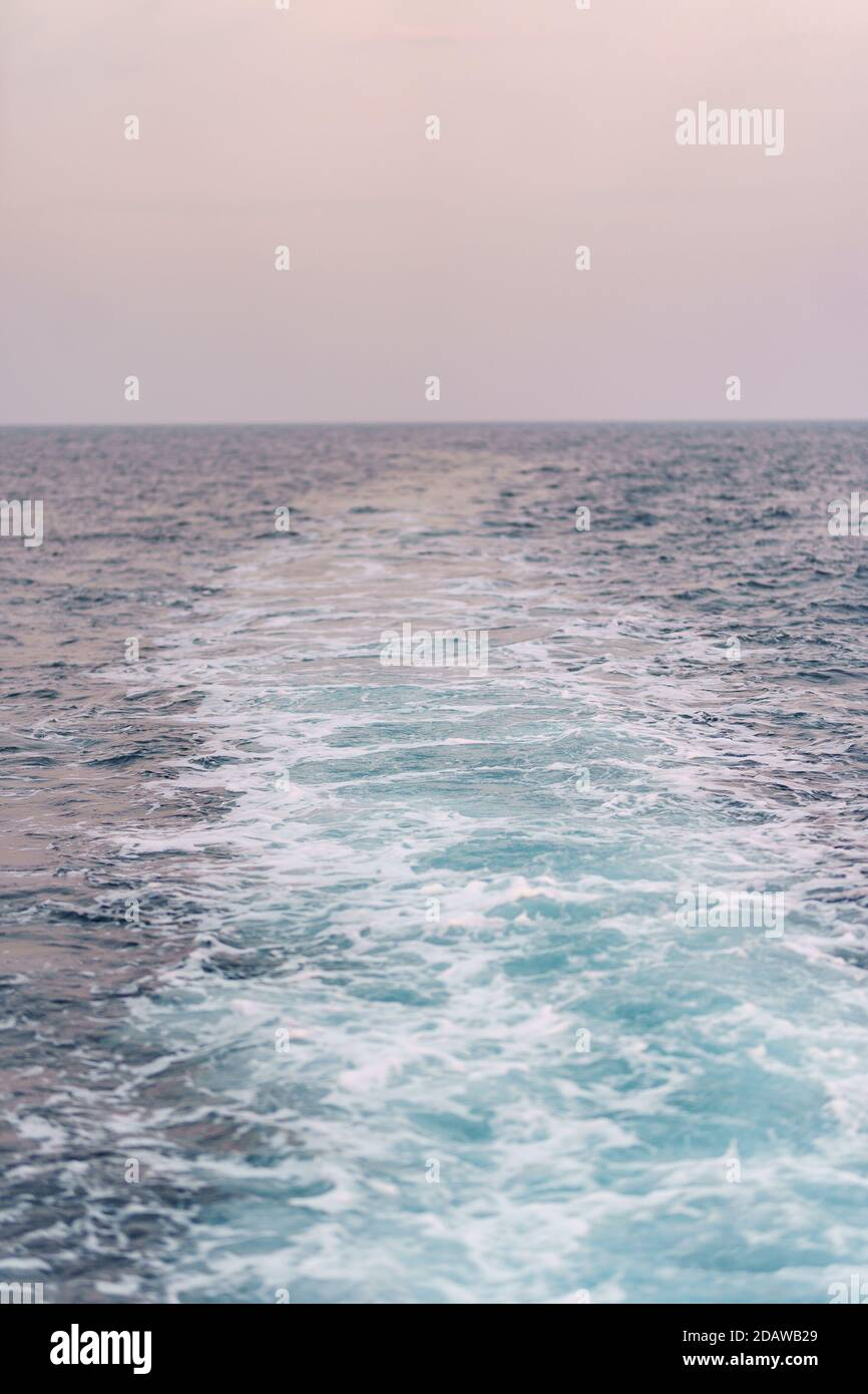 Water surface background. Blue sea water splashes with sun reflections. Ripples of water in the. Stock Photo