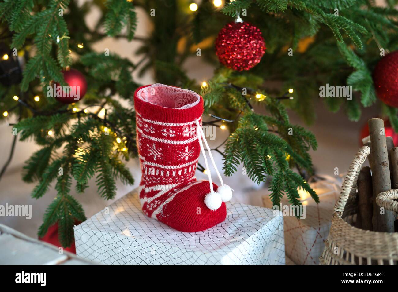 Red Knitted Sock With Ornaments Rustic Christmas Decor Under The Christmas Tree With Lights Of Garlands New Year Home Decor Elements Comfort War Stock Photo Alamy