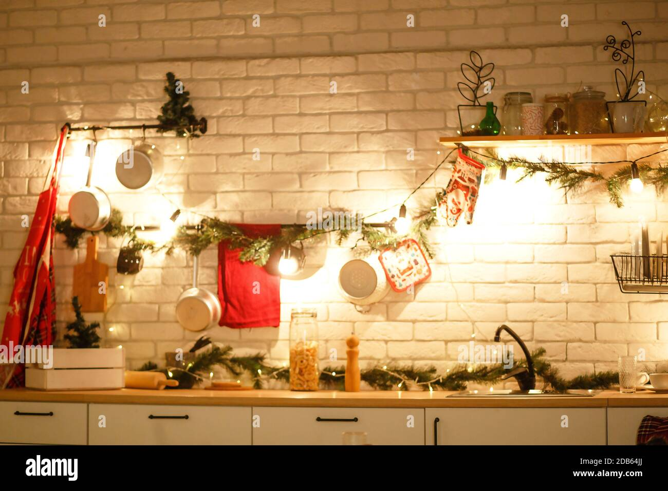 Christmas Decor In The Kitchen Preparing For The Celebration Lights Of Garlands Plates Incandescent Lamps In Loft Style Christmas Tree Kitchen U Stock Photo Alamy