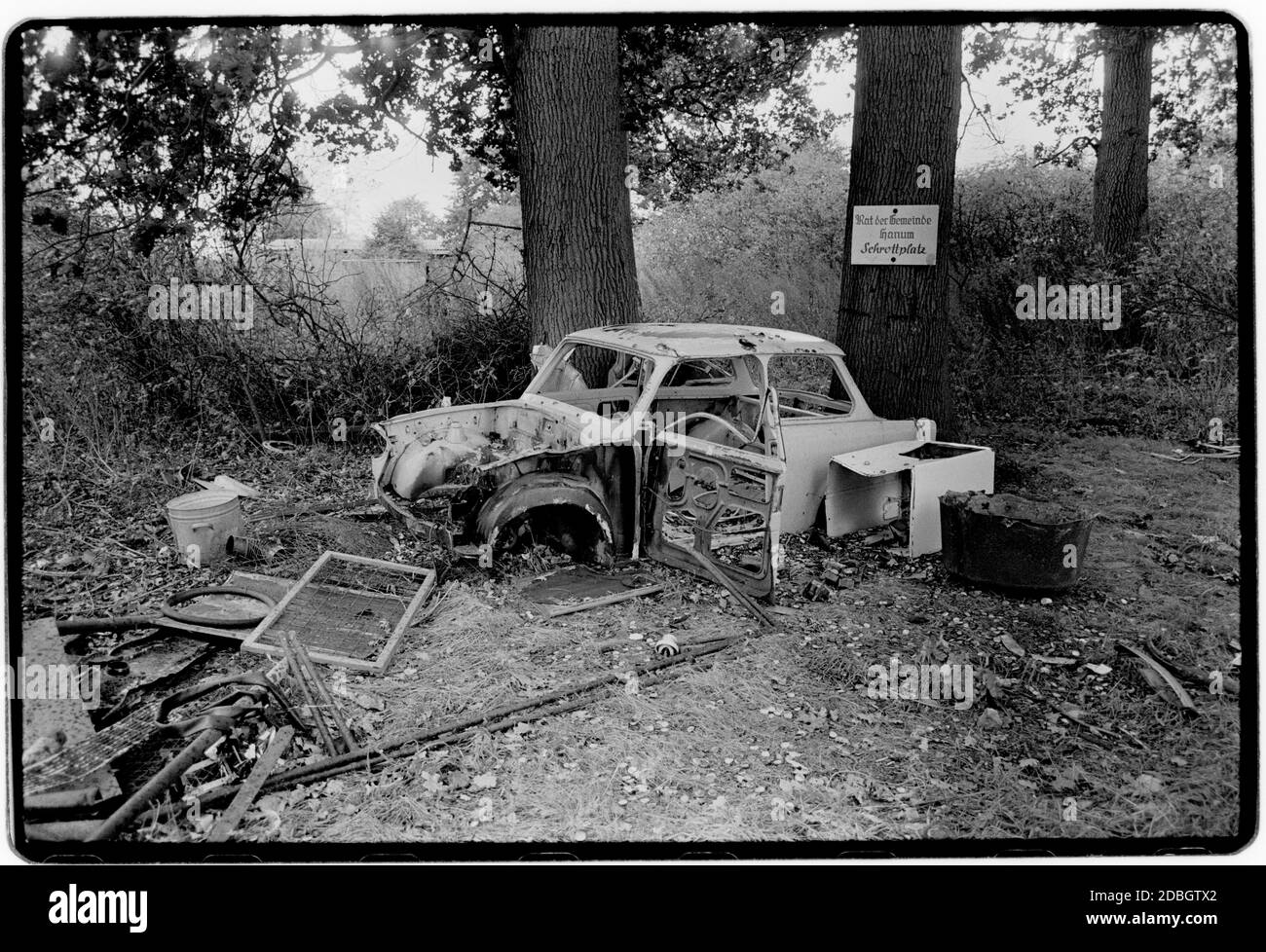 East Germany 1990 scanned in 2020 Trabant car destroyed in Hanum East Germany, Deutsche Demokratische Republik the DDR after the fall of the Wall but before reunification March 1990 and scanned in 2020.East Germany, officially the German Democratic Republic, was a country that existed from 1949 to 1990, the period when the eastern portion of Germany was part of the Eastern Bloc during the Cold War. Stock Photo