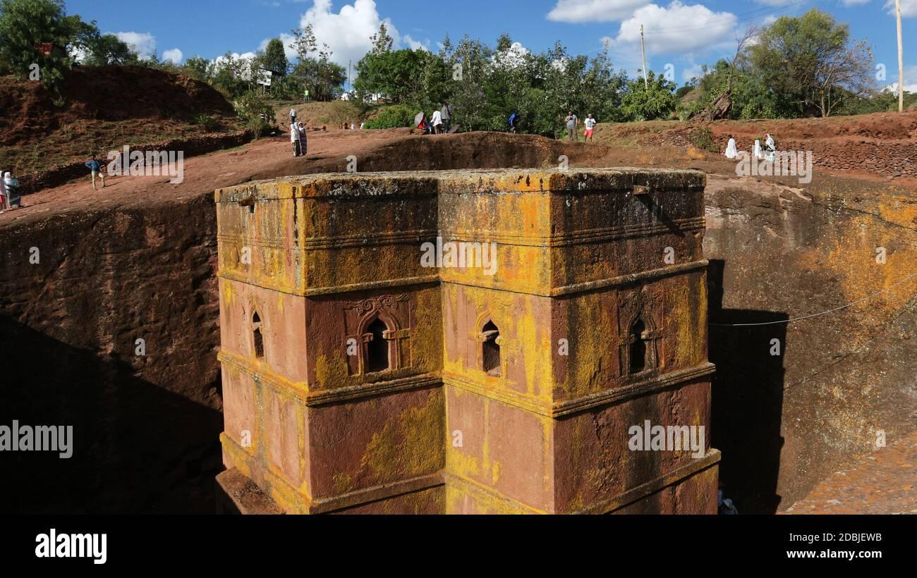Lalibela/Ethiopia - April 12, 2019: Pilgrims visit the rock-hewn Church of St. George Stock Photo