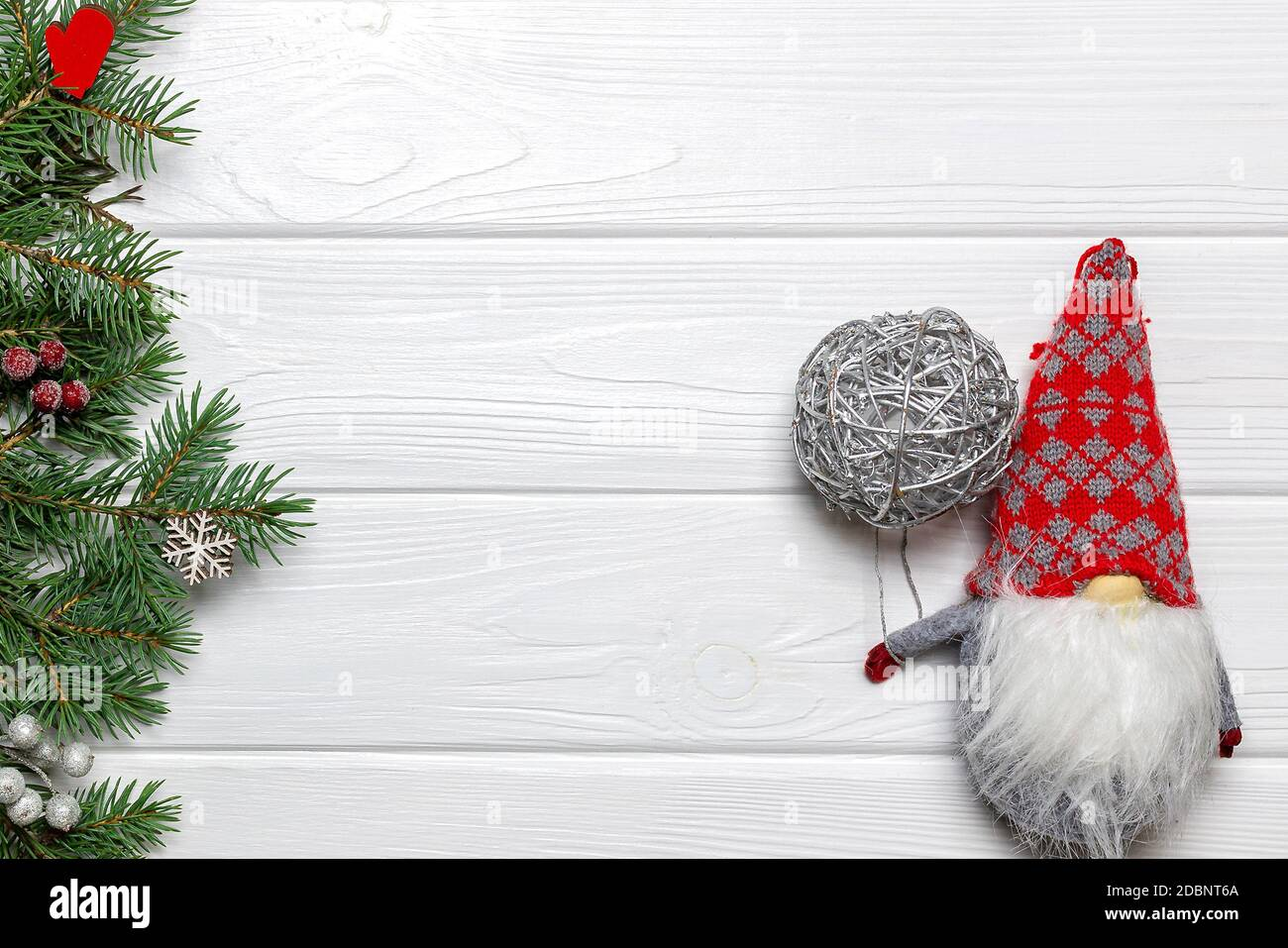 Pine Branches With Snowflake And Mitten Ornaments New Year Gnome With Silver Ball On White Wooden Background Template Copy Space Stock Photo Alamy