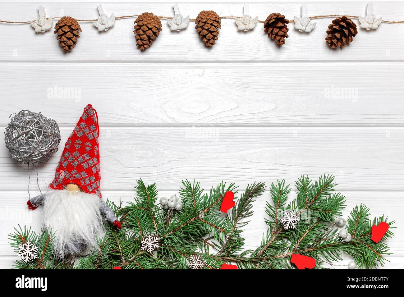 New Year Gnome With Silver Ball Pine Branches With Mitten And Snowflake Ornaments Garland With Cones And Angels Poster Template Copy Space Stock Photo Alamy