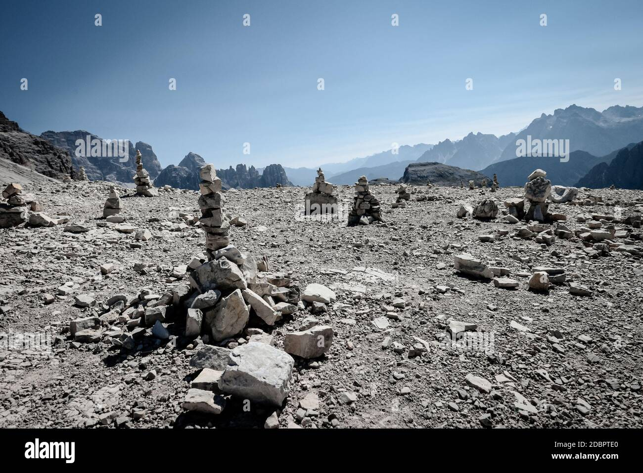 Stacked stones (Cairns) on Monte Paterno (Paternkofel) mountain of the Tre Cime de Lavaredo circuit in the Dolomites, European Alps, northern Italy. Stock Photo