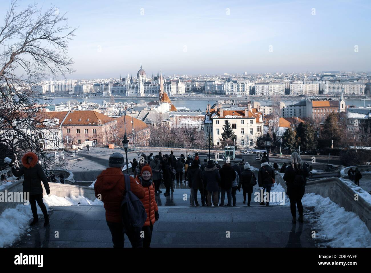 Tourism at Fisherman's Bastion (hungarian: Halászbástya) on a snowy winter day in Budapest, capital of Hungary. Stock Photo