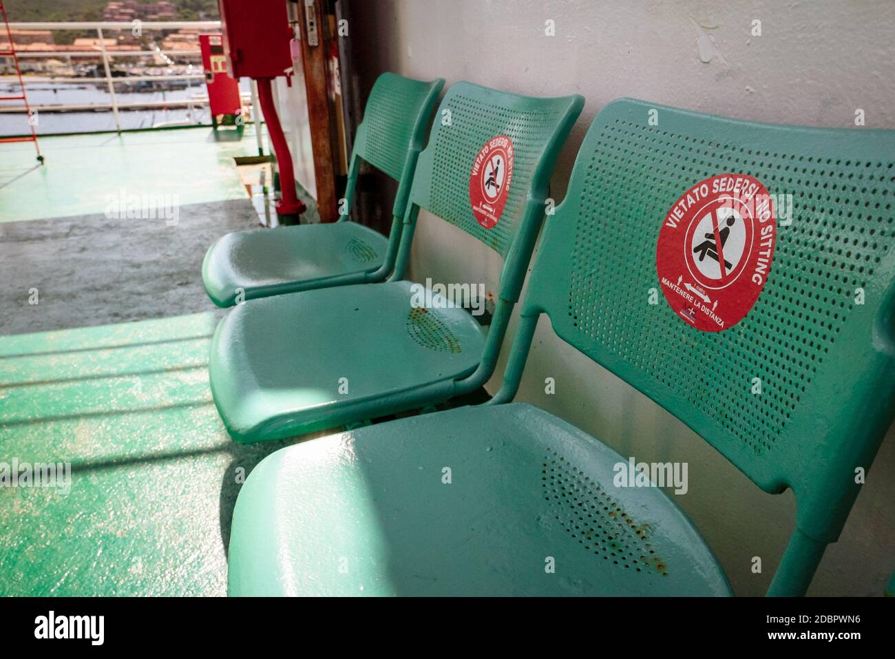 Space markers on a passenger ship to ensure social distancing during the coronavirus crisis in Olbia, Sardinia, Italy. Stock Photo
