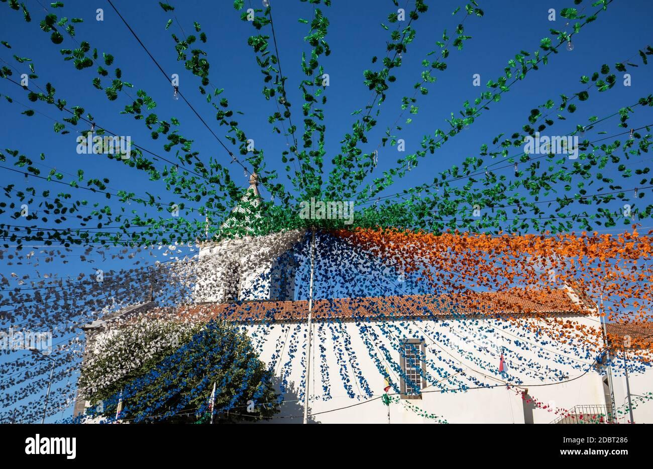 ESTREITO DE CAMARA DE LOBOS, PORTUGAL - SEPTEMBER 10, 2016: Garlands, street decorations at  Madeira Wine Festival in Estreito de Camara de Lobos, Mad Stock Photo