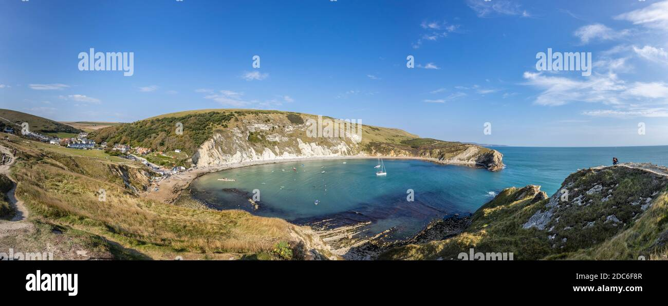 Picturesque coastal view of Lulworth Cove and Portland limestone cliff strata on the Jurassic Coast World Heritage site in Dorset, south-west England Stock Photo