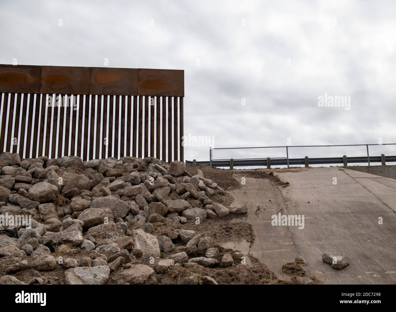 A section where the new Trump Wall meets the old barrier along the U.S. - Mexican border wall October 28, 2020 near McAllen, Texas. Stock Photo
