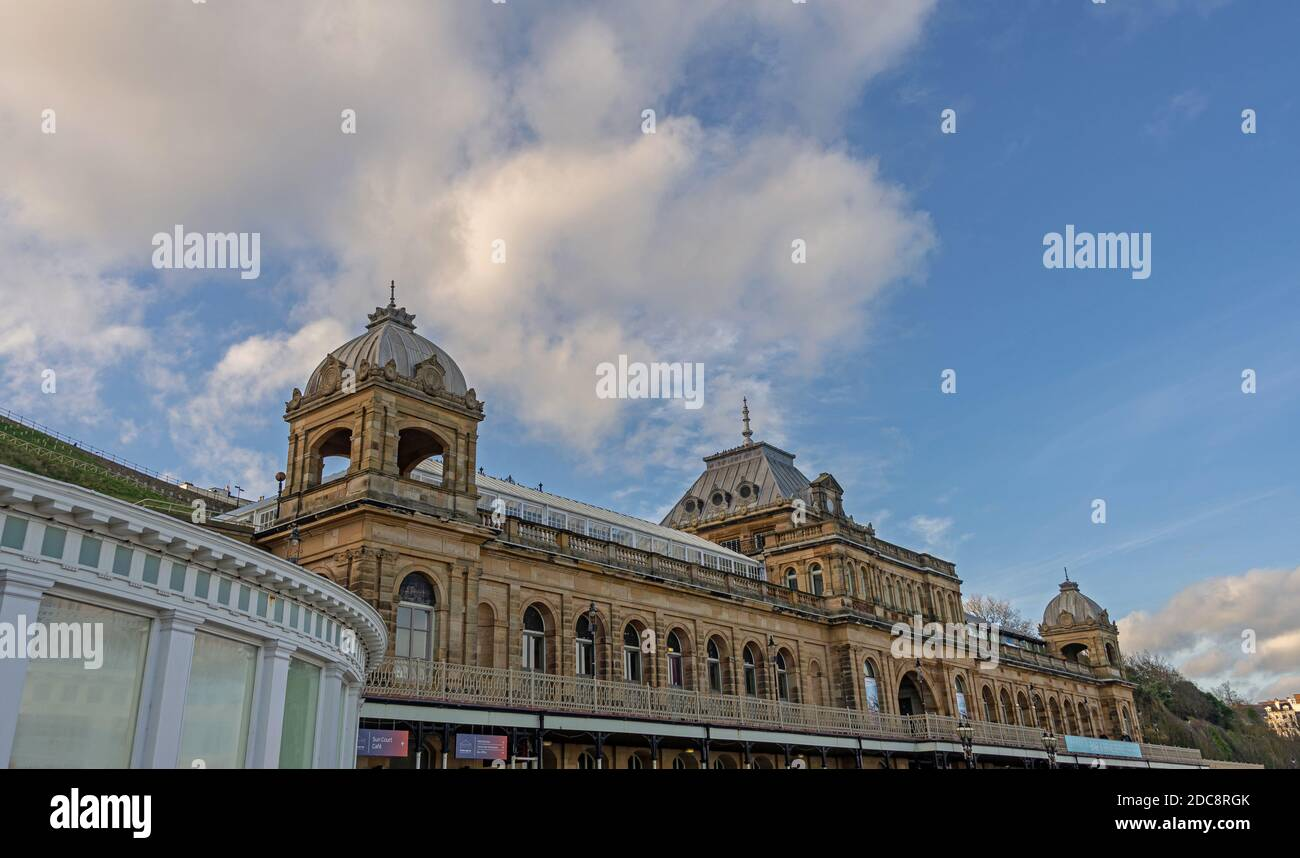 Scarborough Spa entertainment and conference centre.  A Victorian building showing the upper floor and towers. A blue sky is above. Stock Photo