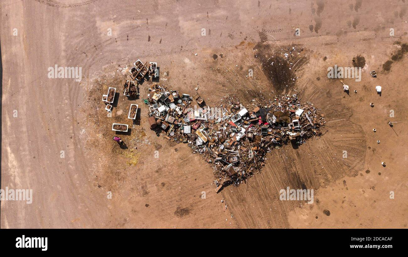 Aerial view of scrapyard. Ecological recycling iron and metal materials from drone view. Background texture concept. Stock Photo