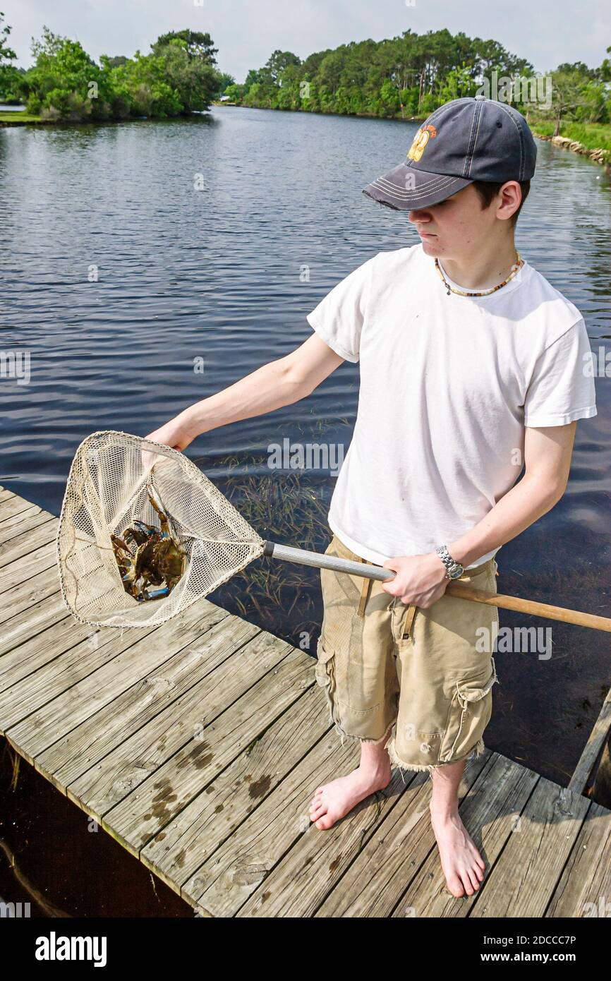 Louisiana, South, St. Tammany Parish, Slidell, Liberty Bayou, crabbing, sightseeing visitors travel traveling tour tourist tourism landmark internatio Stock Photo