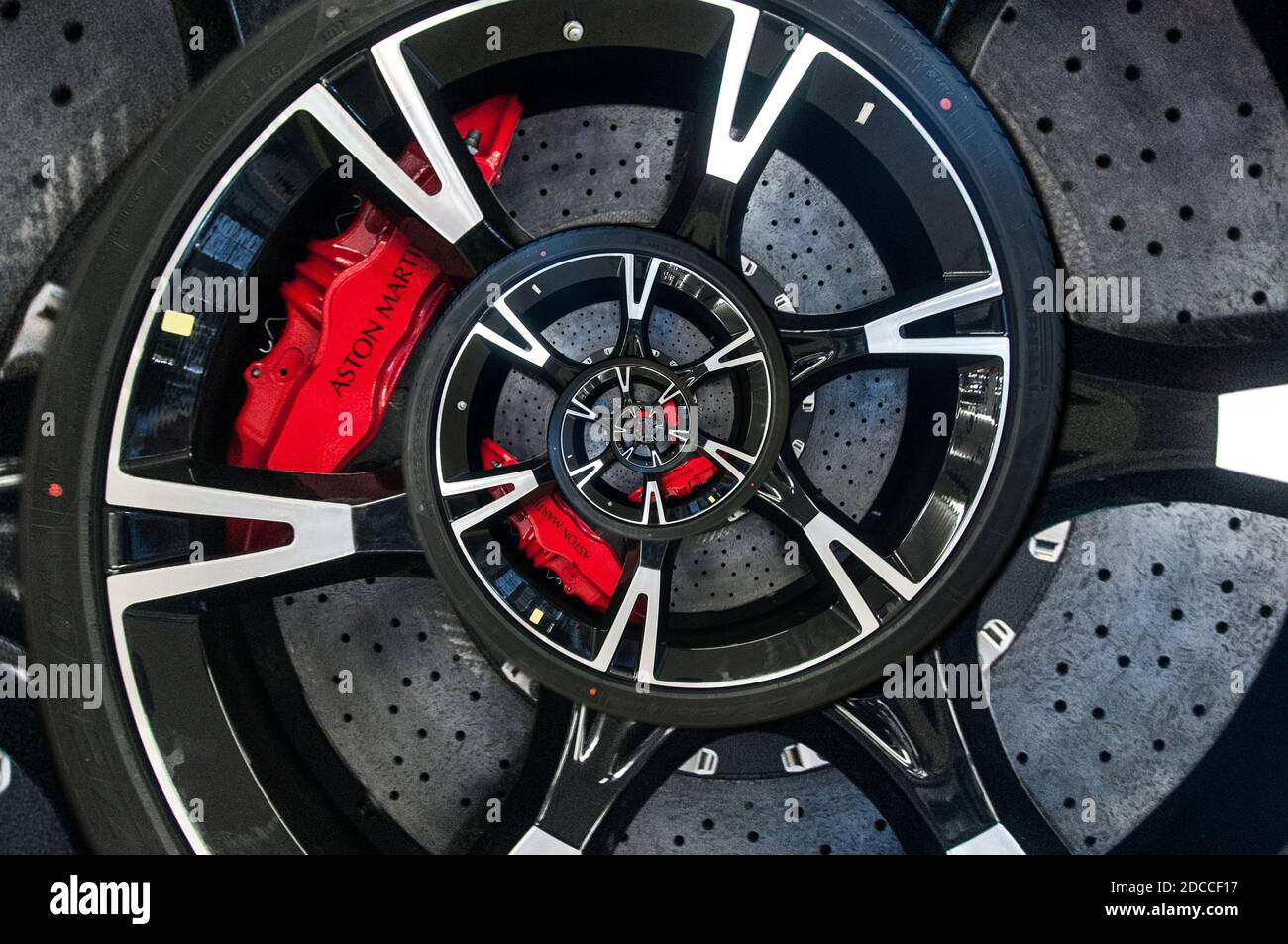 Around the UK - images with a twist. Abstract spherical distorted images. An Aston Martin car wheel showing the Aston red brake calliper & brake disc. Stock Photo