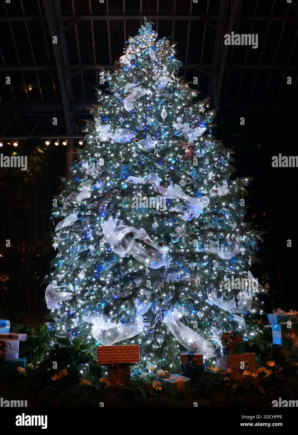 A Beautiful Christmas Tree Decorated With Blue And Silver Ornaments Stock Photo Alamy