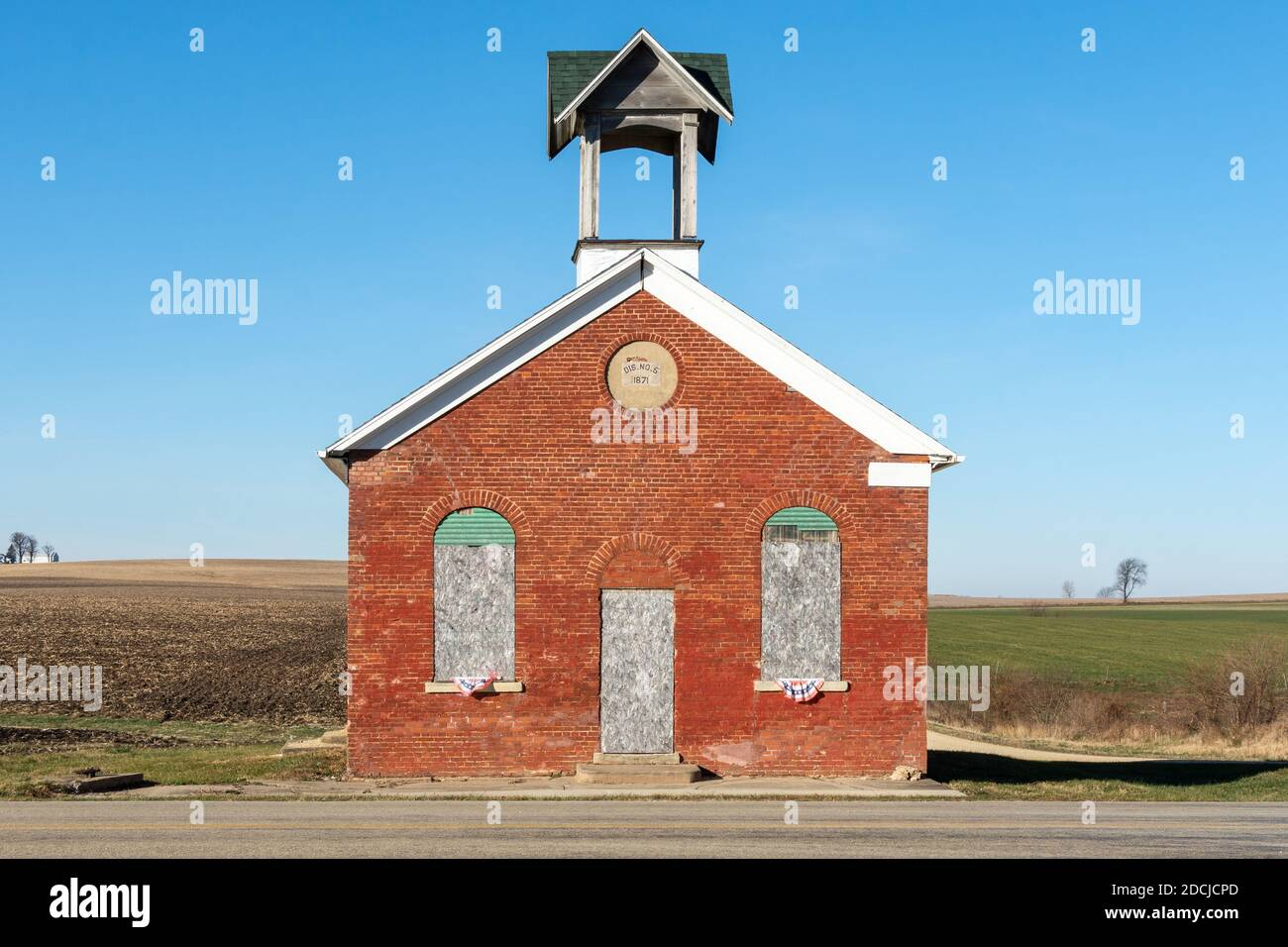 Old one room schoolhouse with farm fields behind.  German Valley, Illinois. Stock Photo
