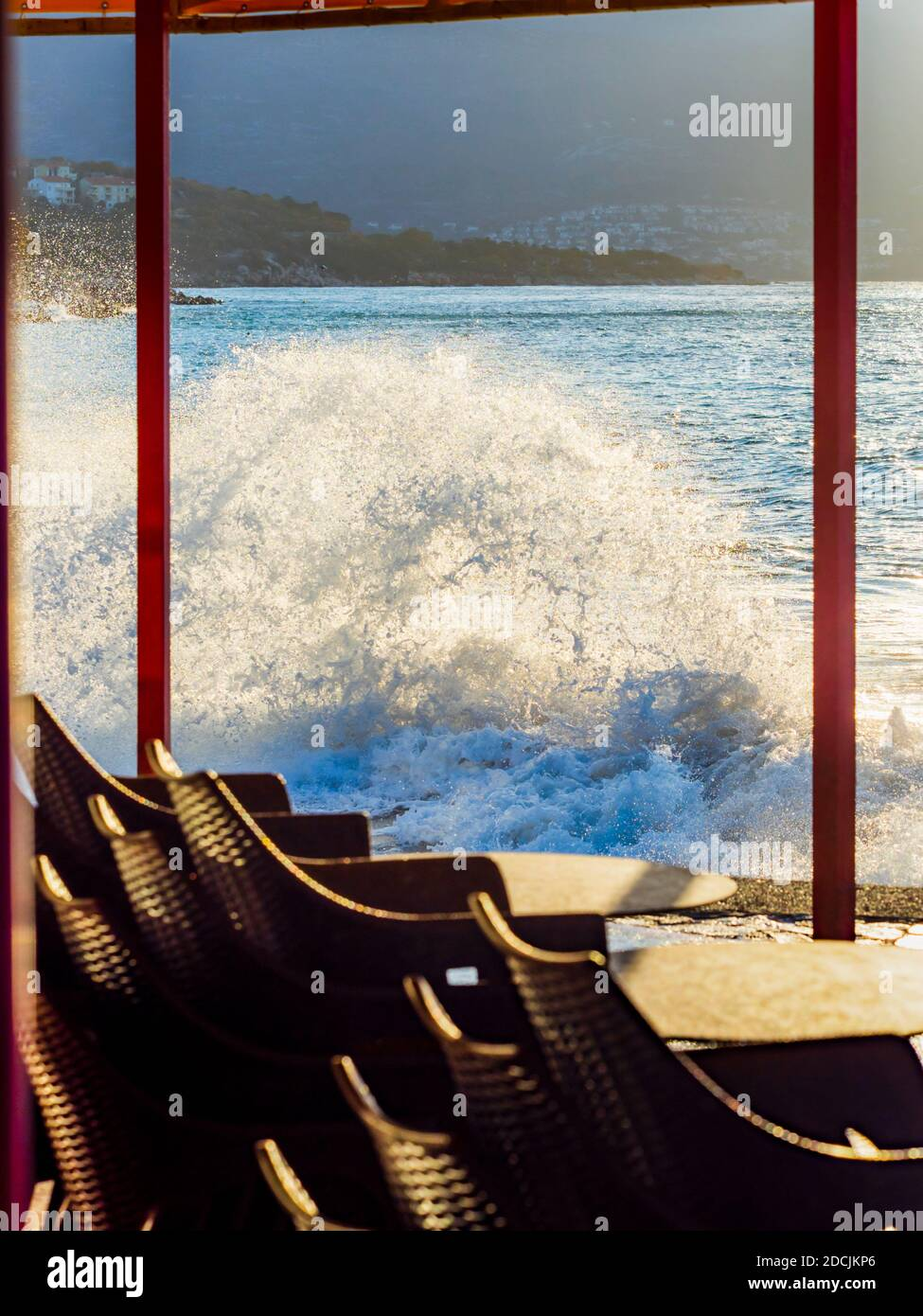 Framed severe windy stormy storm high sea waves lined stored chairs Novi Vinodolski in Croatia Stock Photo