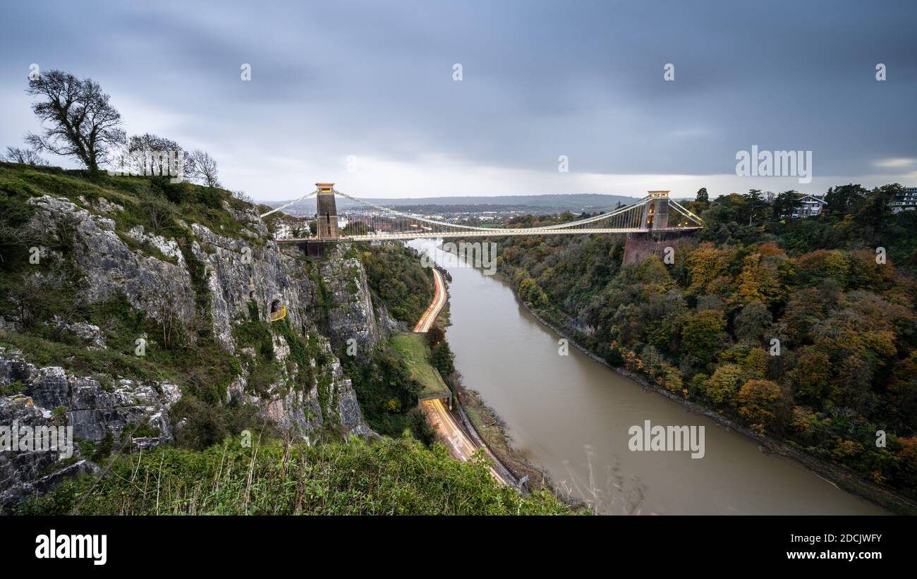 Storm clouds drift over the landmark Clifton Suspension Bridge at dusk in Bristol. Stock Photo