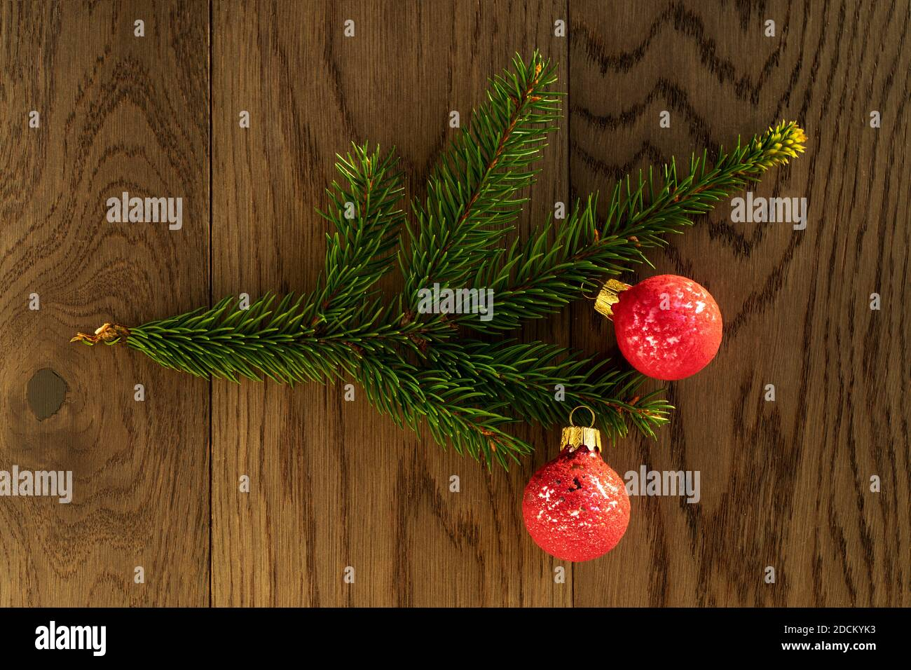 Christmas Decoration A Branch Of Fir Tree With Three Pink Baubles On Rustic Wooden Background Holiday Time Theme For Christmas And New Year Stock Photo Alamy