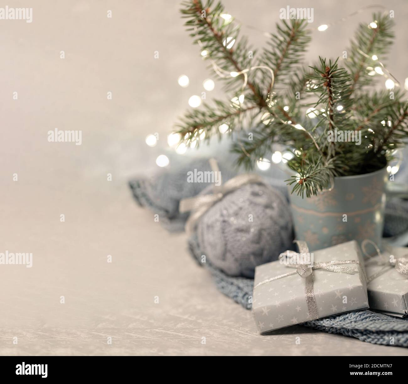 Cozy Winter Christmas Composition With Fir Branches In Mug Xmas Lights Diy Gift Boxes Knitted Xmas Ball Warm Homely Danish Hygge Concept Hugge A Stock Photo Alamy