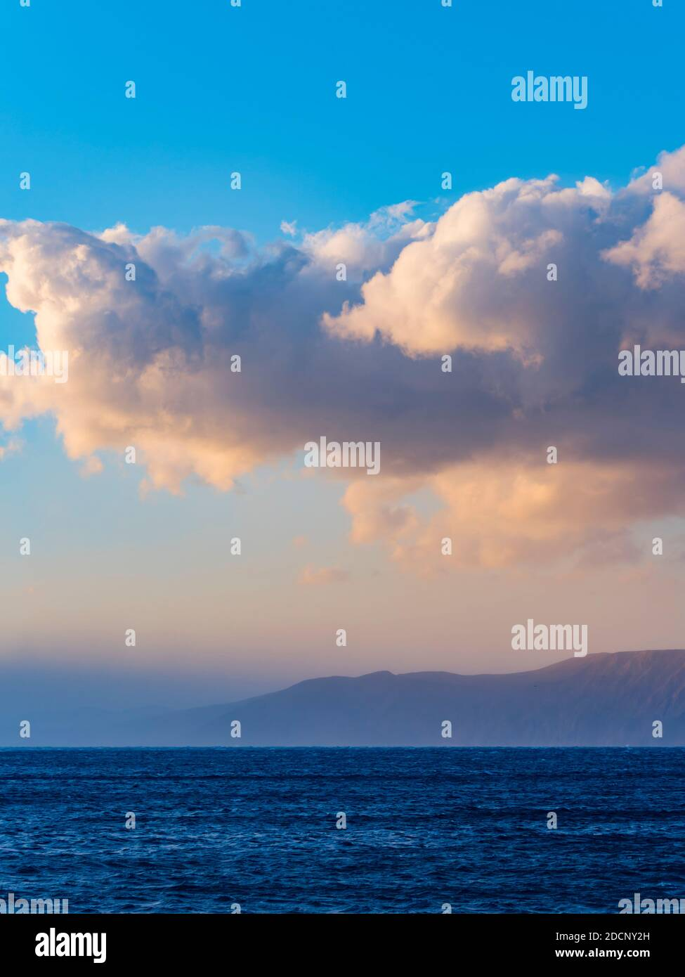 Dawn early morning distant sea surface coastline milky white floating like fog before storm severe weather called jugo near Novi Vinodolski in Croatia Stock Photo