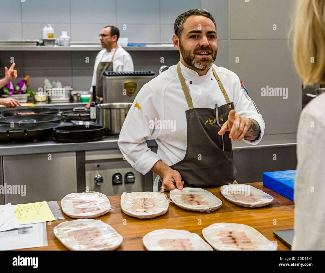 Food journalist Angela Berg in conversation with chef Abraham Artigas of Alabriga Hotel, Sant Feliu de Guíxols, Spain Stock Photo