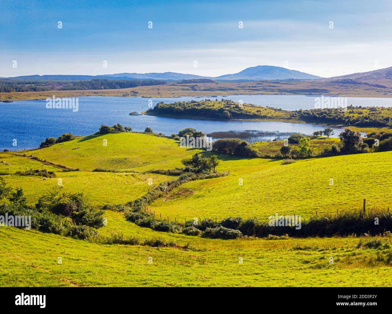 Countryside leading down to Lough Corrib, Connemara, County Galway, Republic of Ireland. Eire. Lough Corrib is the largest lake in the Irish Republic. Stock Photo