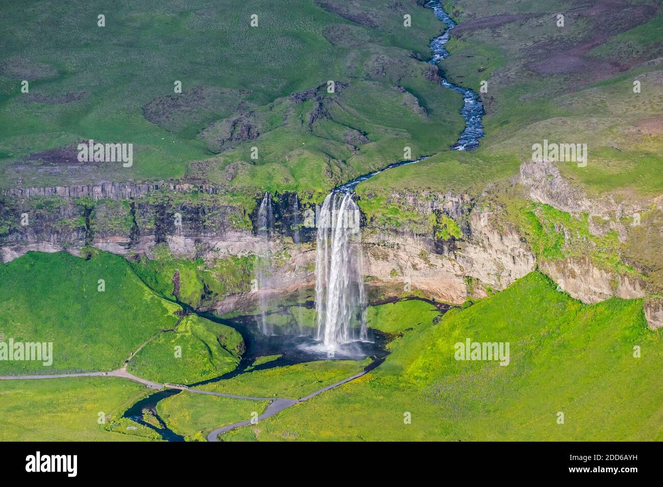 Aerial view over Seljalandsfoss waterfall and the Seljalands River in summer, South Region, Iceland Stock Photo