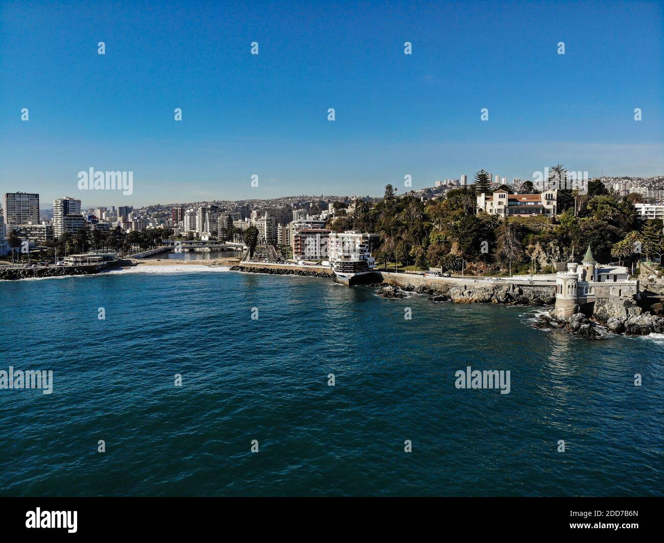 Drone shot of Vina del Mar coast line with a small castle, a restaurant and river Stock Photo