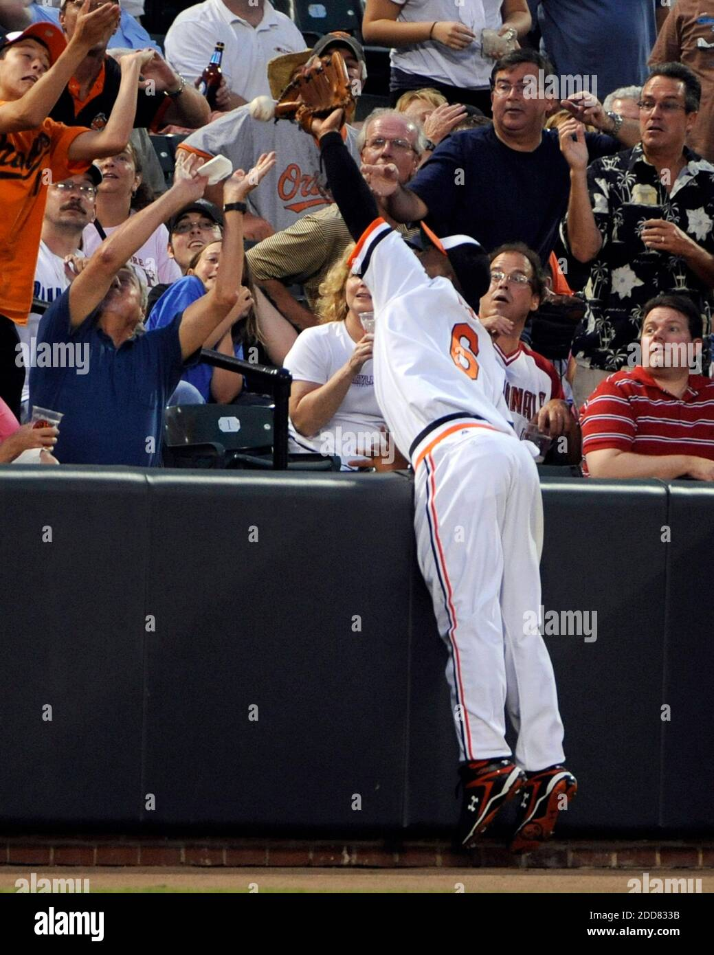 The Baltimore Orioles' Melvin Mora can't catch a foul pop as he dives into the stands on a ball hit by the Toronto Blue Jays' Matt Stairs in the fourth inning at Oriole Park at Camden Yards in Baltimore, MD, USA on July 23, 2008. Photo by Lloyd Fox/Baltimore Sun/MCT/Cameleon/ABACAPRESS.COM Stock Photo