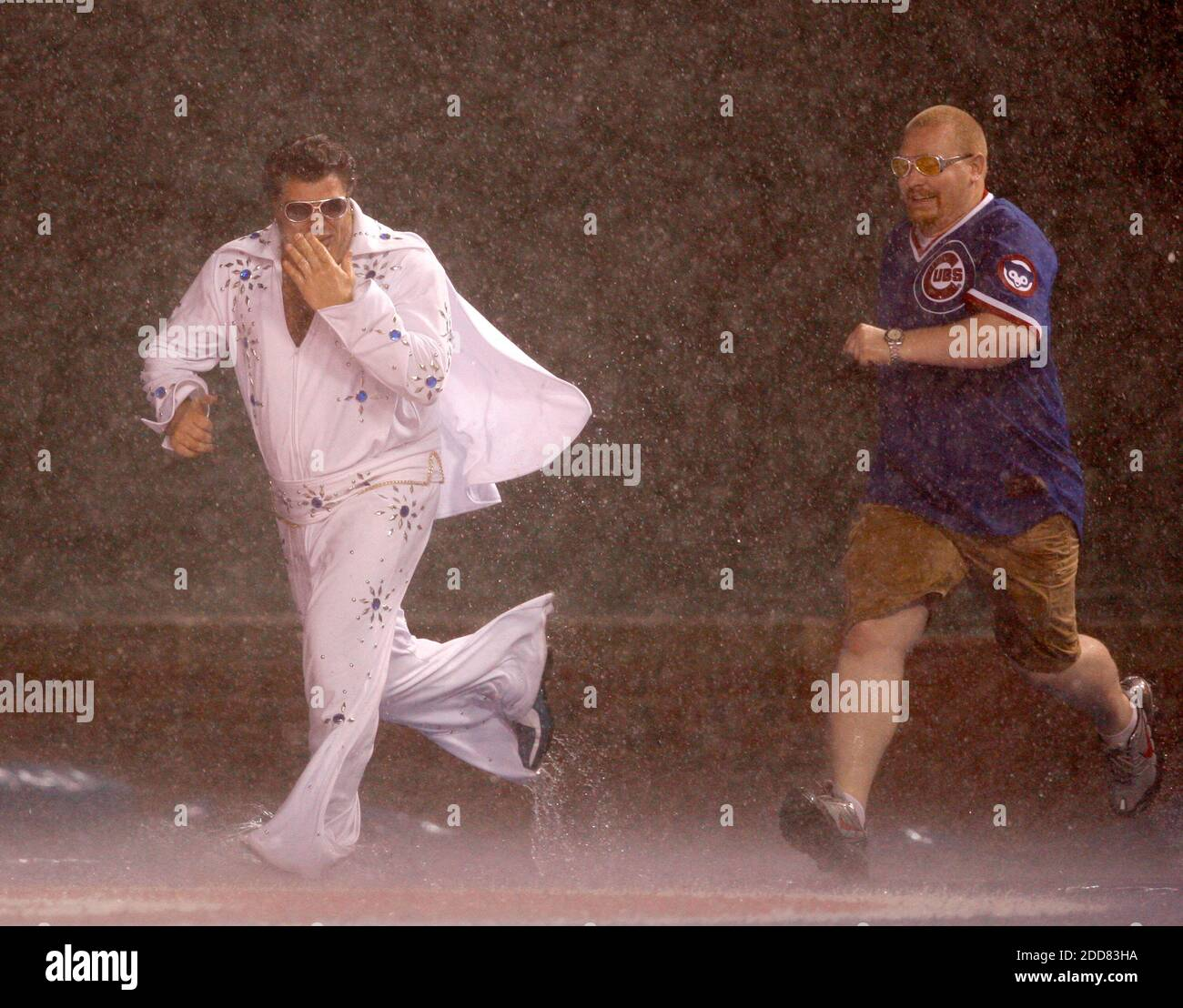 Chicago Cubs fans are arrested after sliding on the tarp during a rain delay in the Cubs game against the Houston Astros at Wrigley Field in Chicago, Illinois, on Monday August 4, 2008. Photo by Nuccio DiNuzzo/Chicago Tribune/MCT/Cameleon/ABACAPRESS.COM Stock Photo